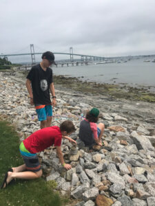 the boys love to make rock towers at the ocean